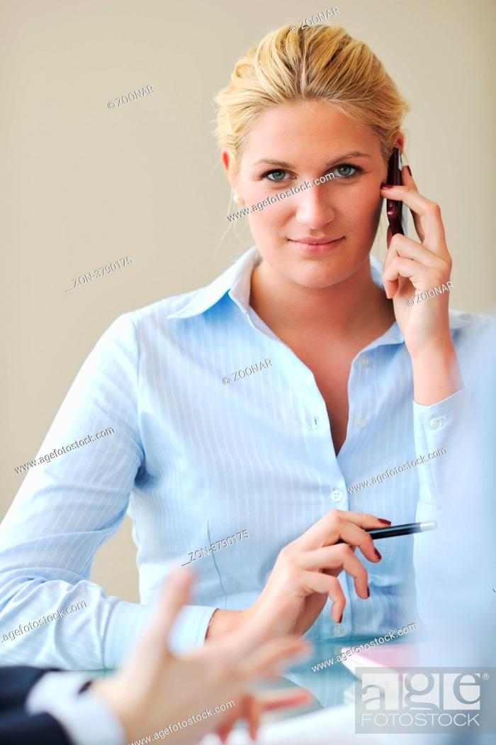 Stock Photo: blonde young business woman talk by cellphone on meetng.