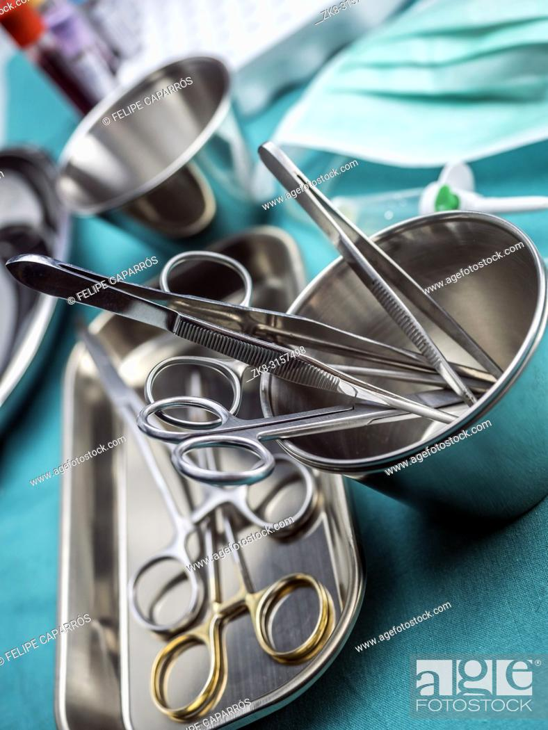 Stock Photo: Some scissors for surgery on a tray in an operating theater, conceptual image.