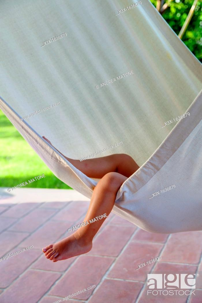 Stock Photo: Small child leg over hammock.