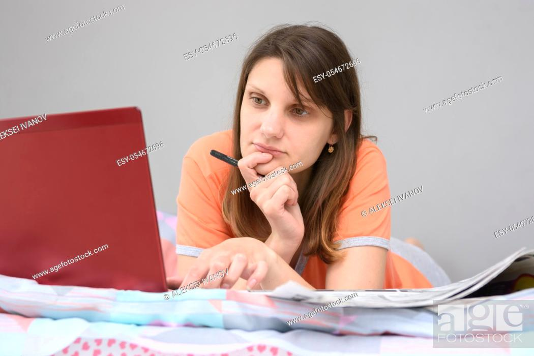Stock Photo: Girl looking for work on online sites on the Internet.