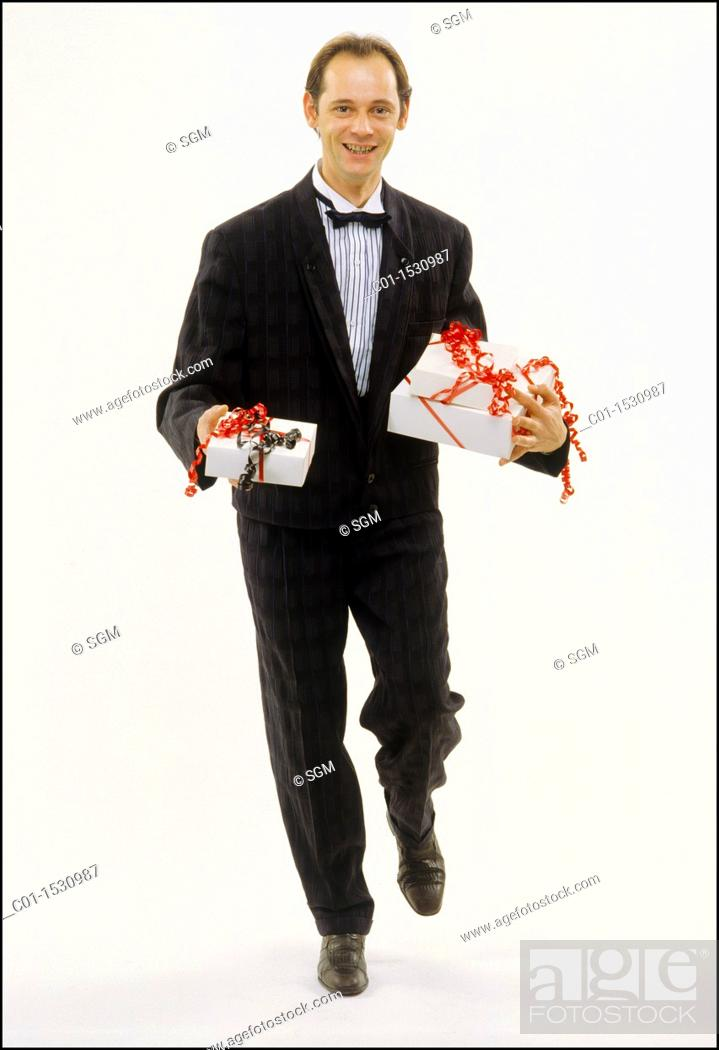 Stock Photo: Mr Young man with black dress and presents.