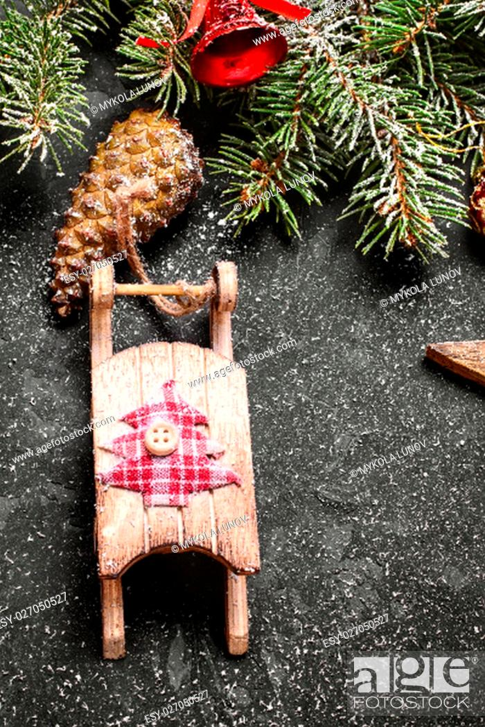 Stock Photo: Spruce branches with pinecones and Christmas ornaments.