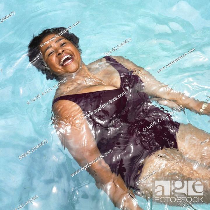 Stock Photo: Senior Mixed Race woman in swimming pool.