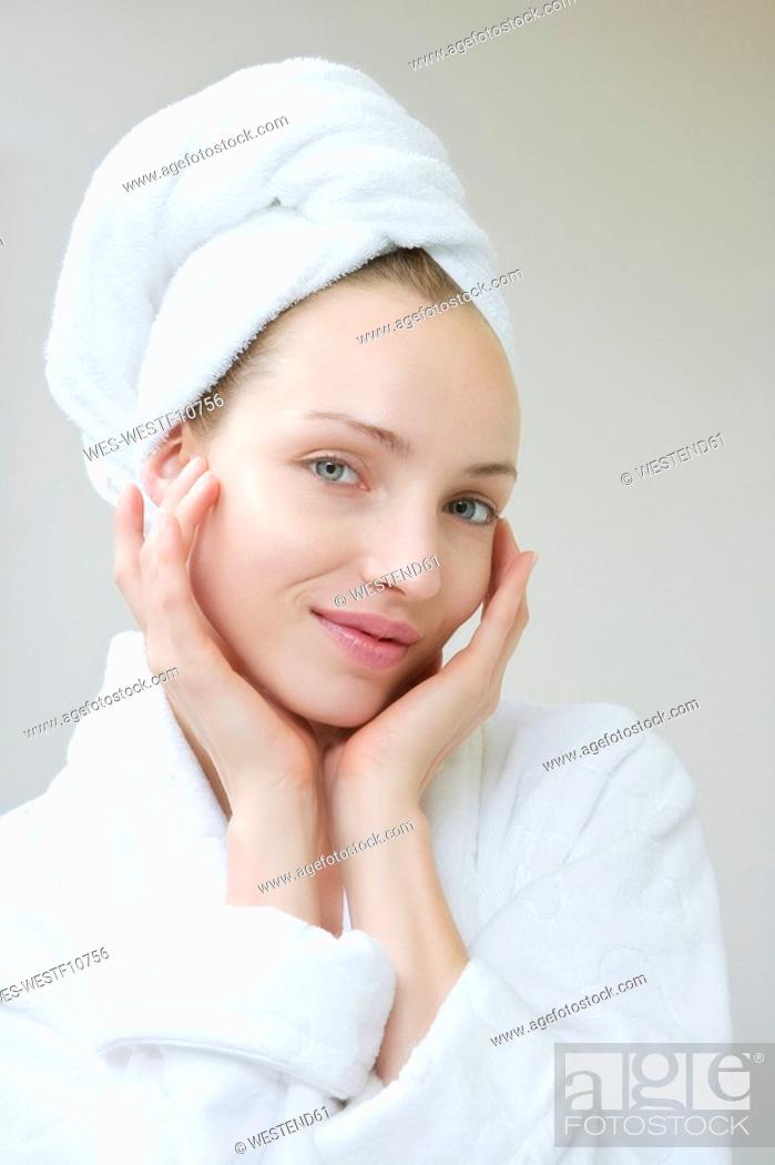 Stock Photo: Young woman wearing towel on head, portrait.