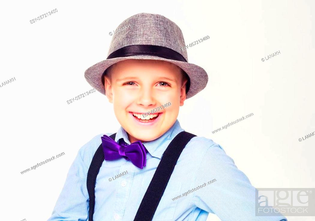 Stock Photo: happy child wearing a hat, isolated against white.