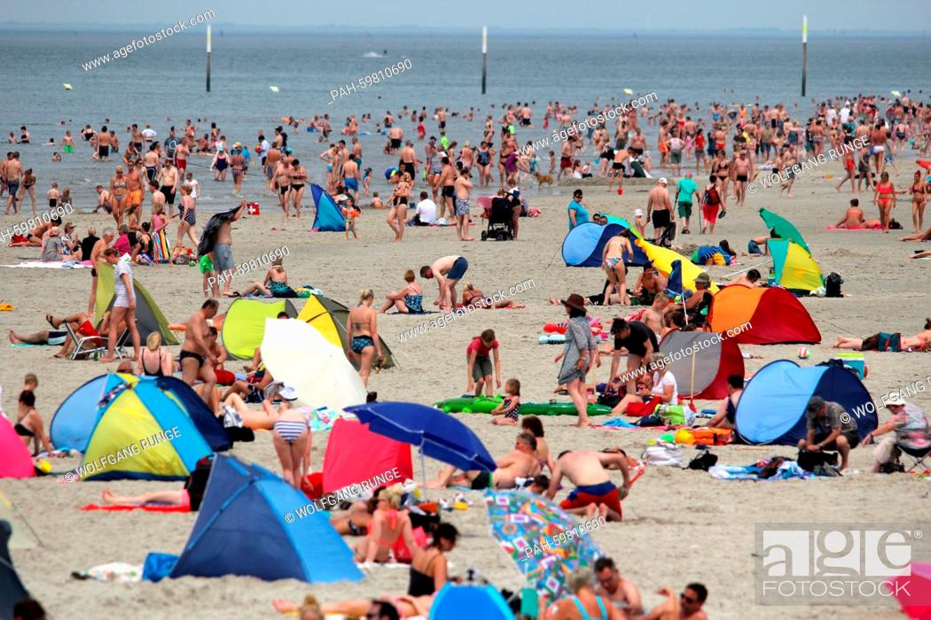 Stock Photo: Holidaymakers enjoy the summer weather on the beach at St. Peter-Ording, Germany, 4 July 2015. PHOTO: WOLFGANG RUNGE/DPA   usage worldwide.