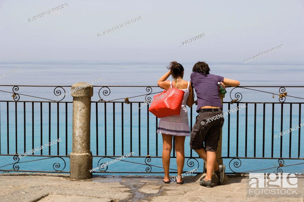 Stock Photo: A couple enjoying the view from the terrace of Corso Vittorio Emmanuele, Tropea, Vibo Valentia, Calabria, Southern Italy, Italy.