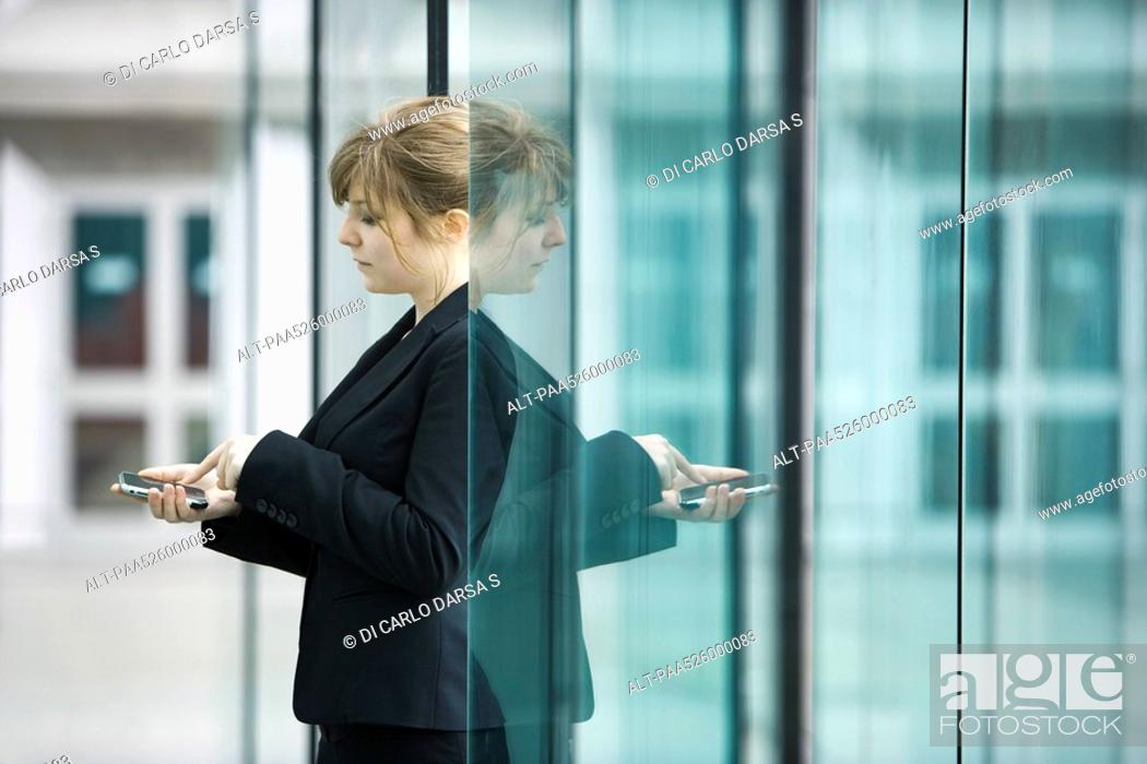 Stock Photo: Businesswoman using cell phone.