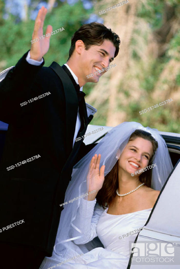 Stock Photo: Newlywed couple waving.
