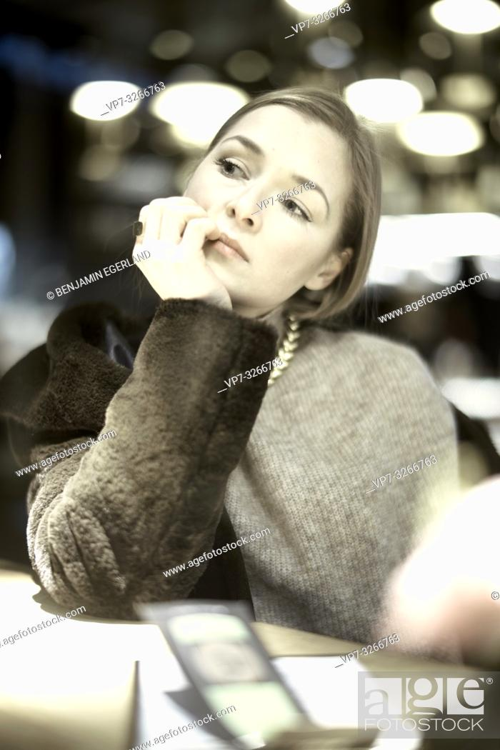 Stock Photo: noble woman in restaurant, in Munich, Germany.