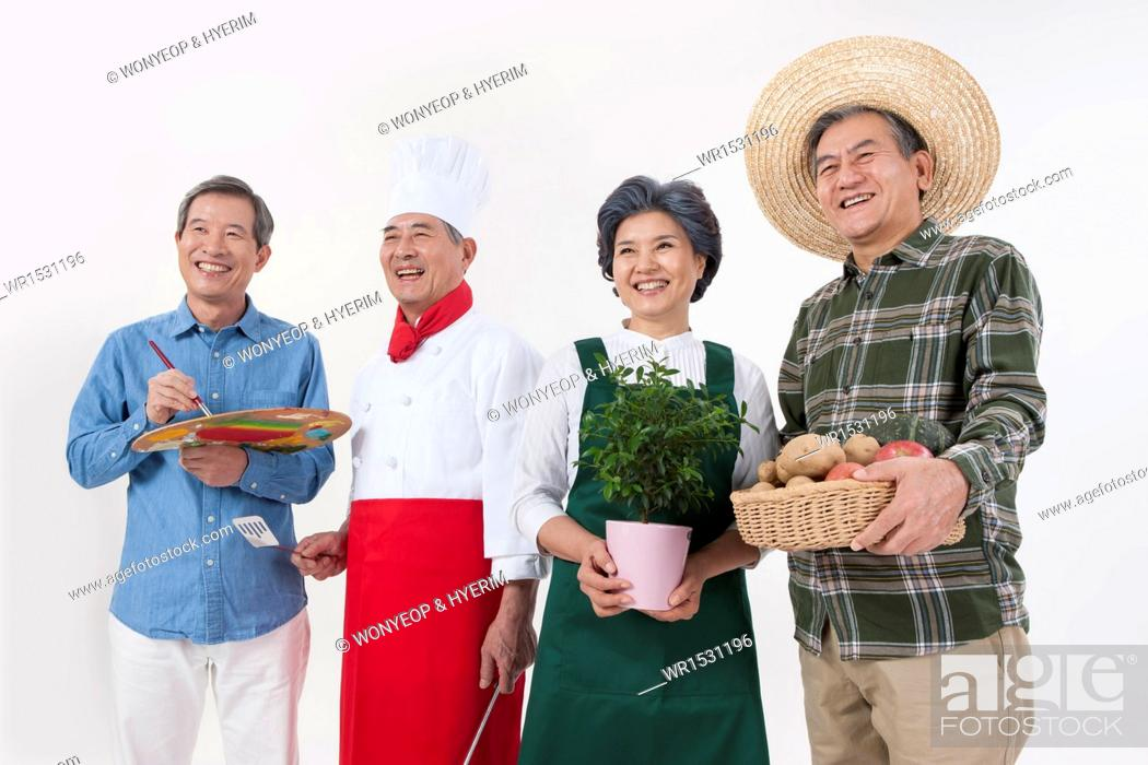 Stock Photo: four old people from different professions posing.