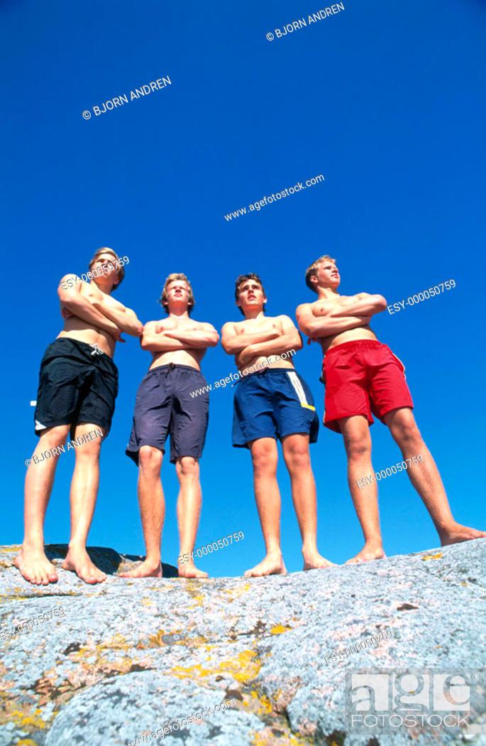 Stock Photo: Teenage boys on the rocks.