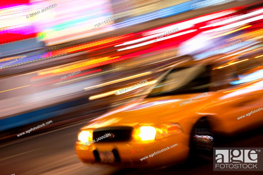 Stock Photo: Taxi cab at night in Times Square, Manhattan, New York City, USA.
