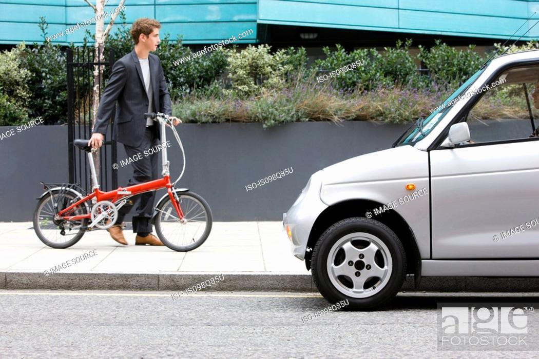 Stock Photo: Man with bicycle.