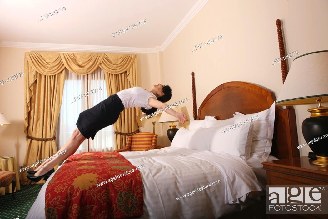 Stock Photo: Jumping back on bed.