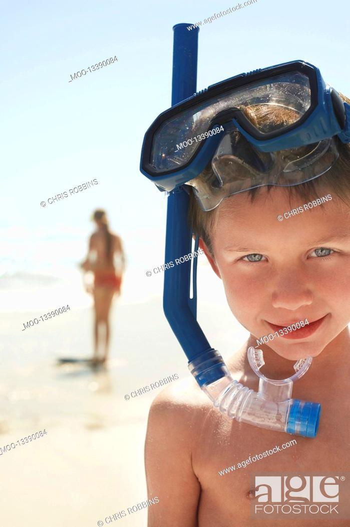 Stock Photo: Boy 5-6 in snorkel on beach close-up portrait.
