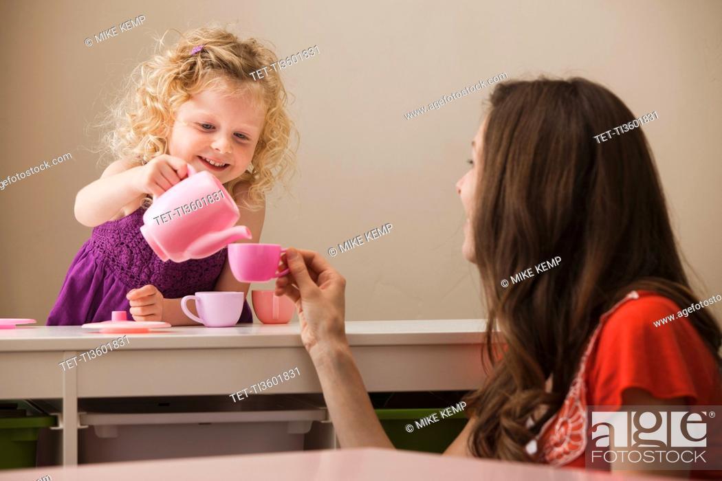 Stock Photo: USA, Utah, Lehi, mother and daughter 2-30 having tea.