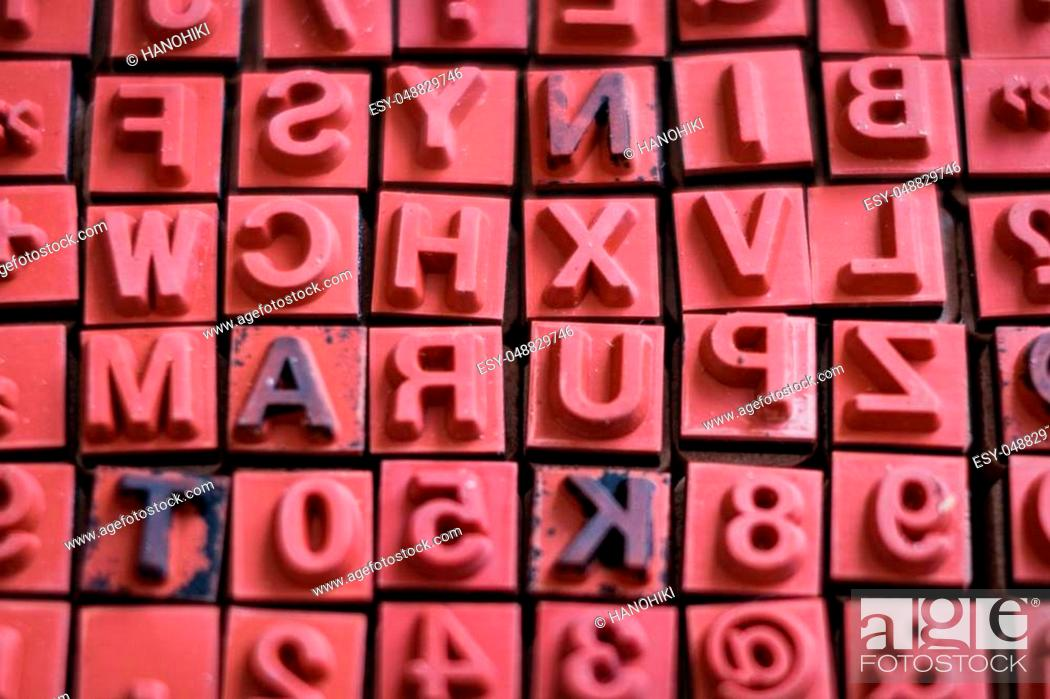 Stock Photo: letter and number stamps macro - alphabet letterpress.