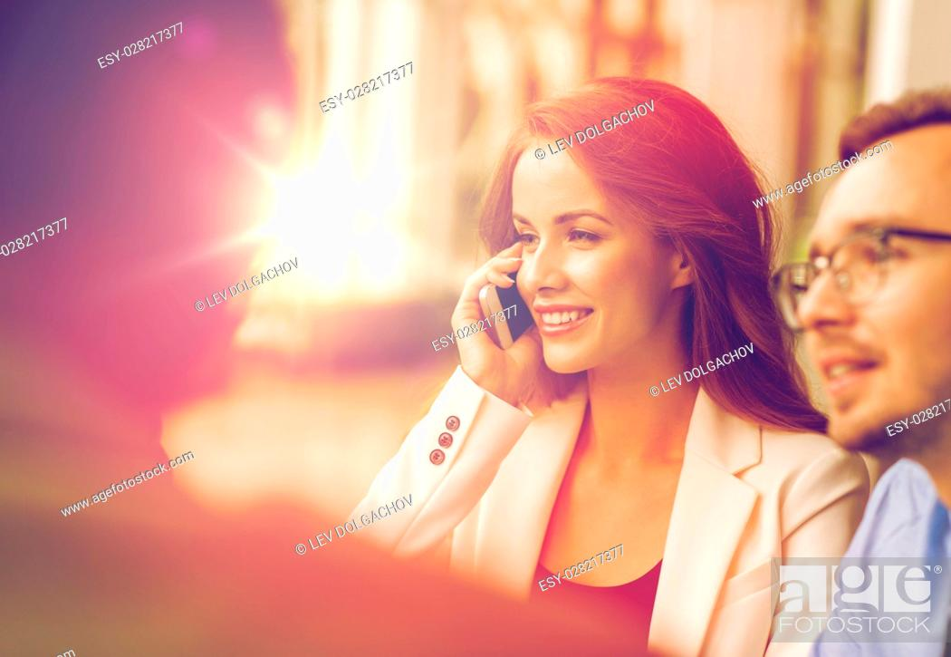 Stock Photo: business, technology, communication and people concept - happy businesswoman calling on smartphone at office.