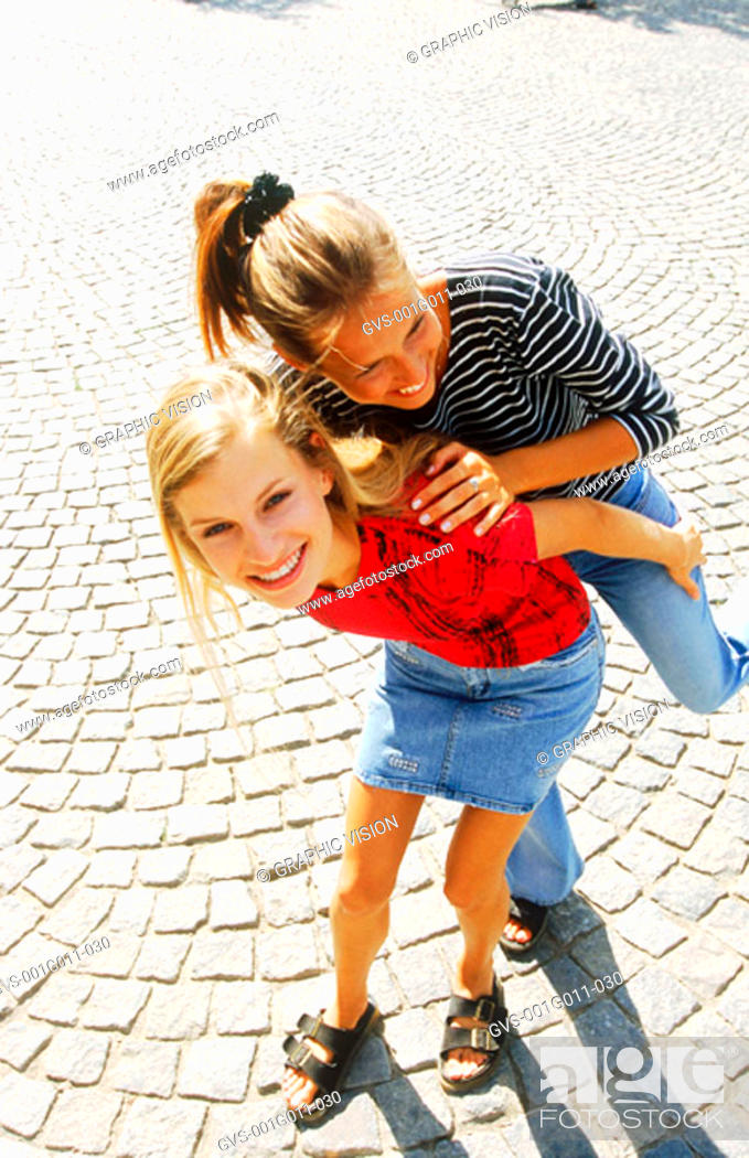 Stock Photo: Two young women playing.