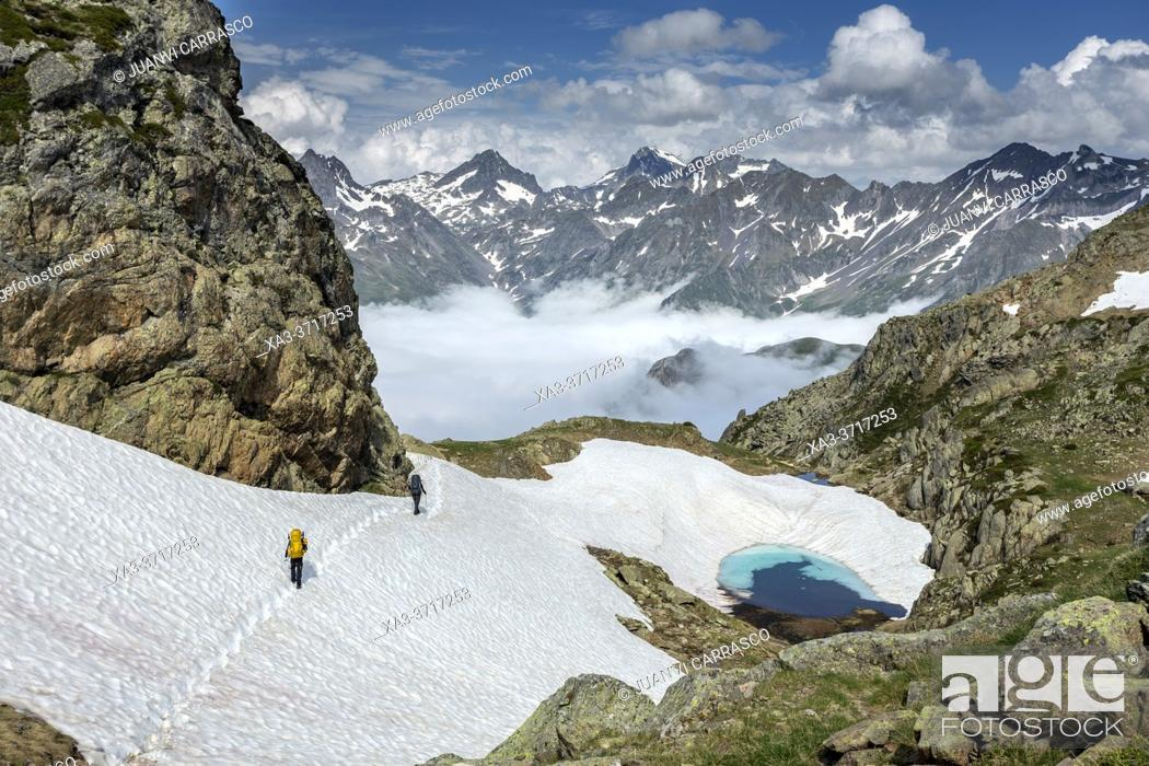 Stock Photo: Two people hiking at Col de Peyreget, Pyrenees national park, France.