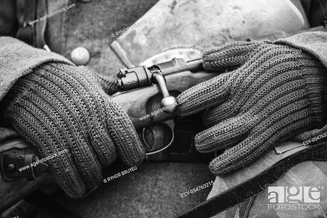 Stock Photo: Close Up Of German Military Ammunition Of A German Wehrmacht Soldier At World War II. Warm Autumn Clothes, Soldier's Overcoat, Gloves, Helmet, Sapper Shovel.