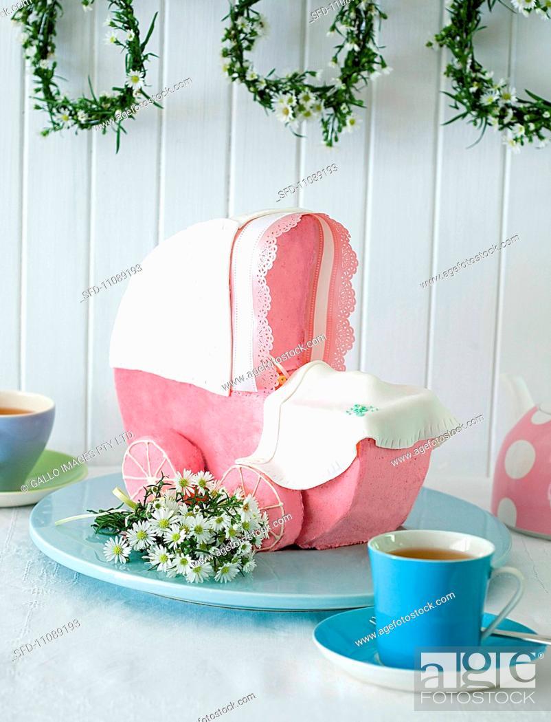 Stock Photo: A sweet pram with raspberry icing.