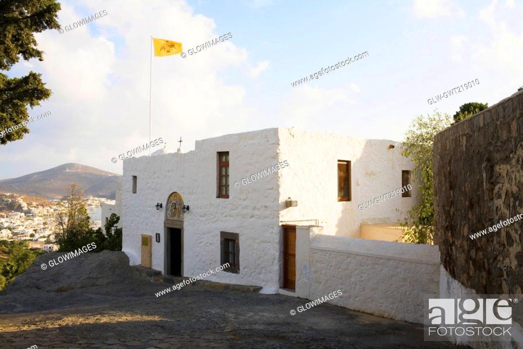 Stock Photo: Flag on a monastery, Monastery of the Apocalypse, Patmos, Dodecanese Islands, Greece.