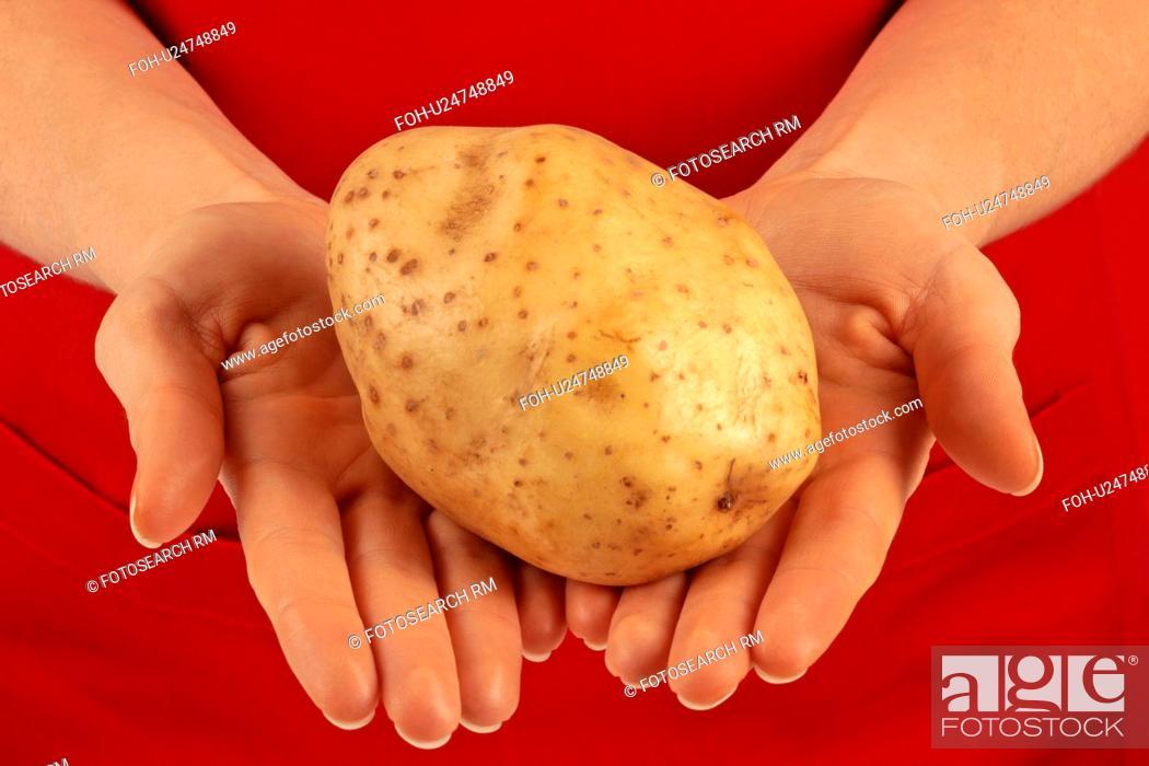 Stock Photo: Woman Holding Baking Potato.