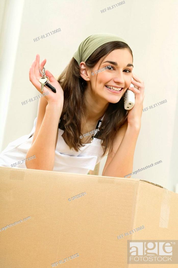 Stock Photo: Woman holding keys to new home.