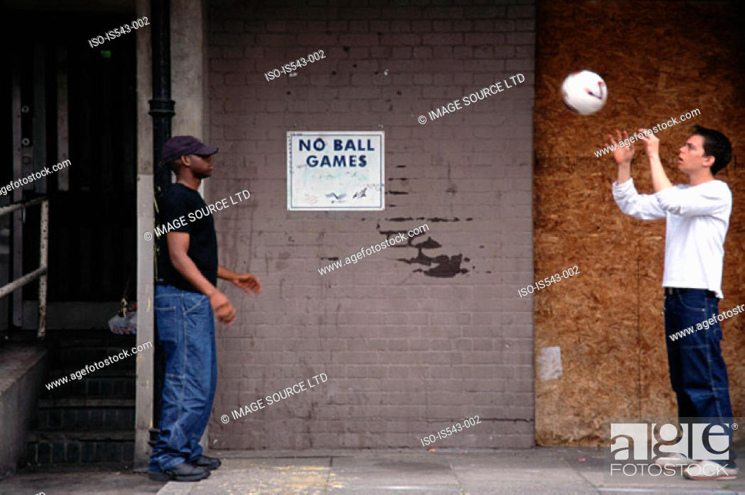 Stock Photo: Boys throwing football.