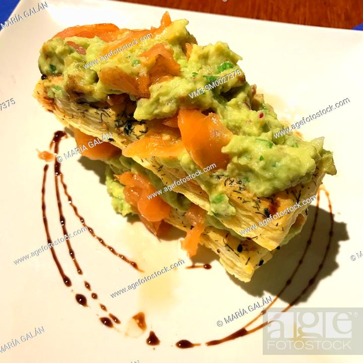 Stock Photo: Puff pastry made of smoked salmon and avocado.