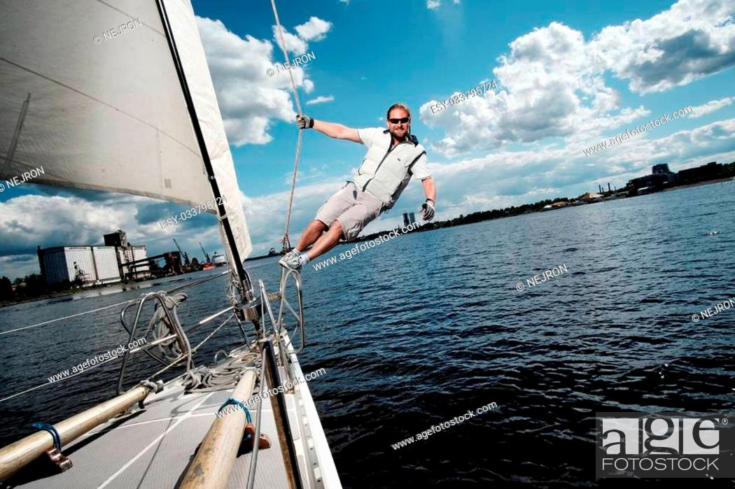 Stock Photo: Captain on a yacht during race.