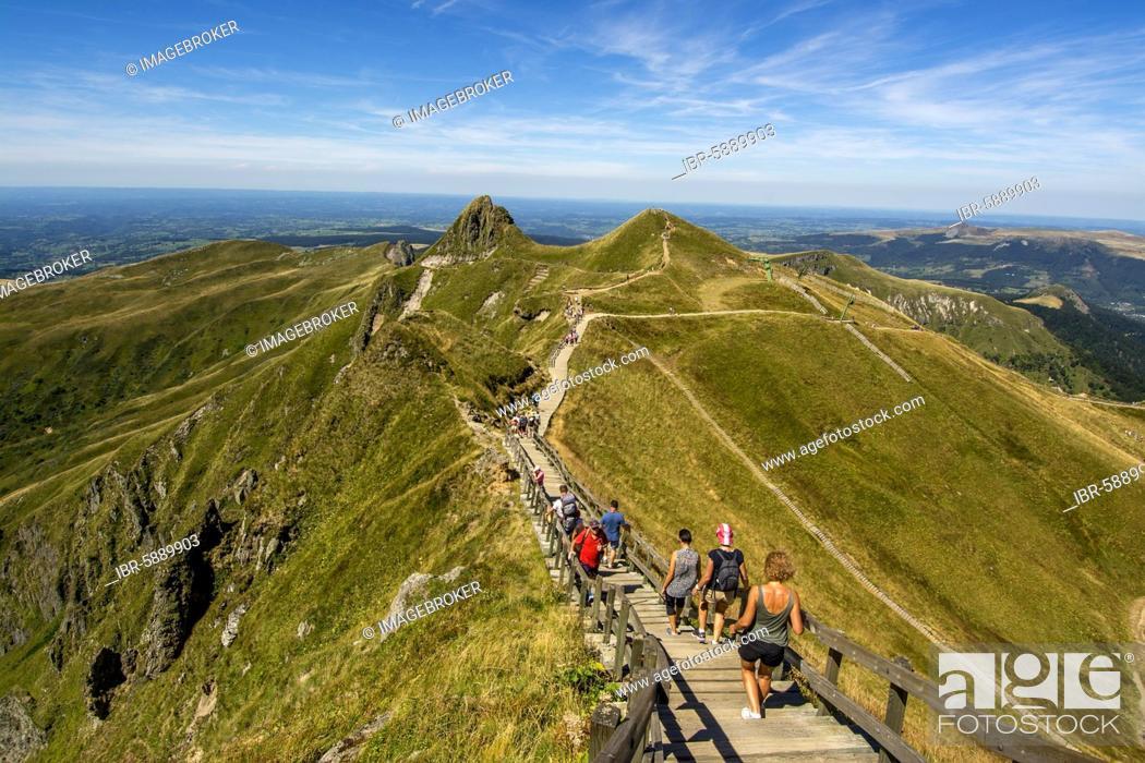 Stock Photo: Hikers on way to top of Puy de Sancy, Auvergne Volcanoes Natural Park, Puy de Dome department, Auvergne-Rhone-Alpes, France, Europe.