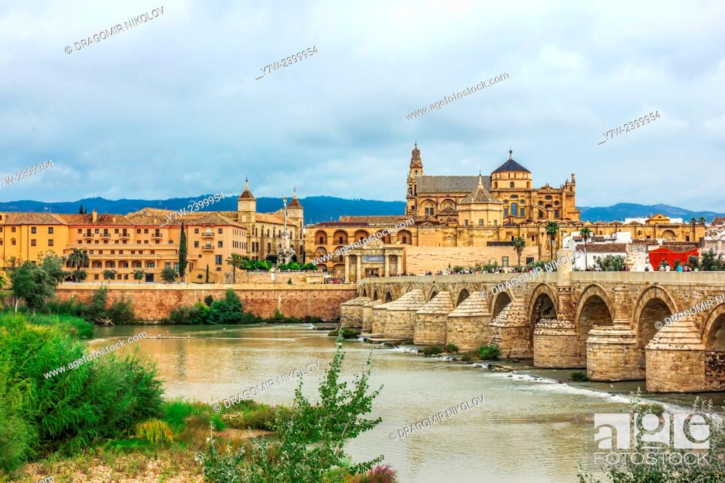 Stock Photo: Roman Bridge on Guadalquivir river and Mezquita Cathedral (Great Mosque) at dawn in the city of Cordoba, Andalusia, Spain.
