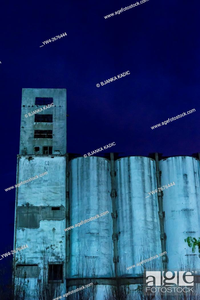 Stock Photo: Disused factory at night, Buenos Aires, Argentina.