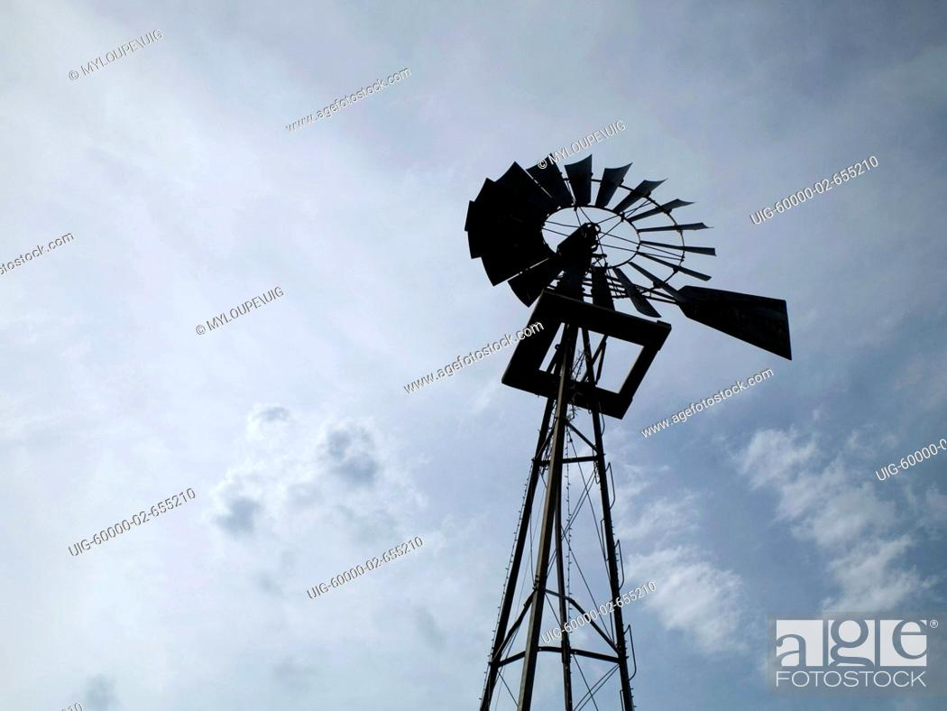 Stock Photo: Windmill and blue sky.