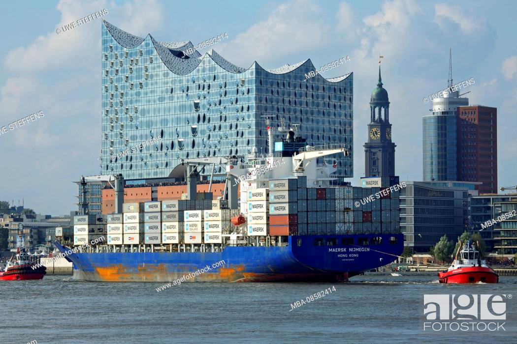 Stock Photo: From the Hansahafen expiring container ship in front of Michel and Elbphilharmonie.