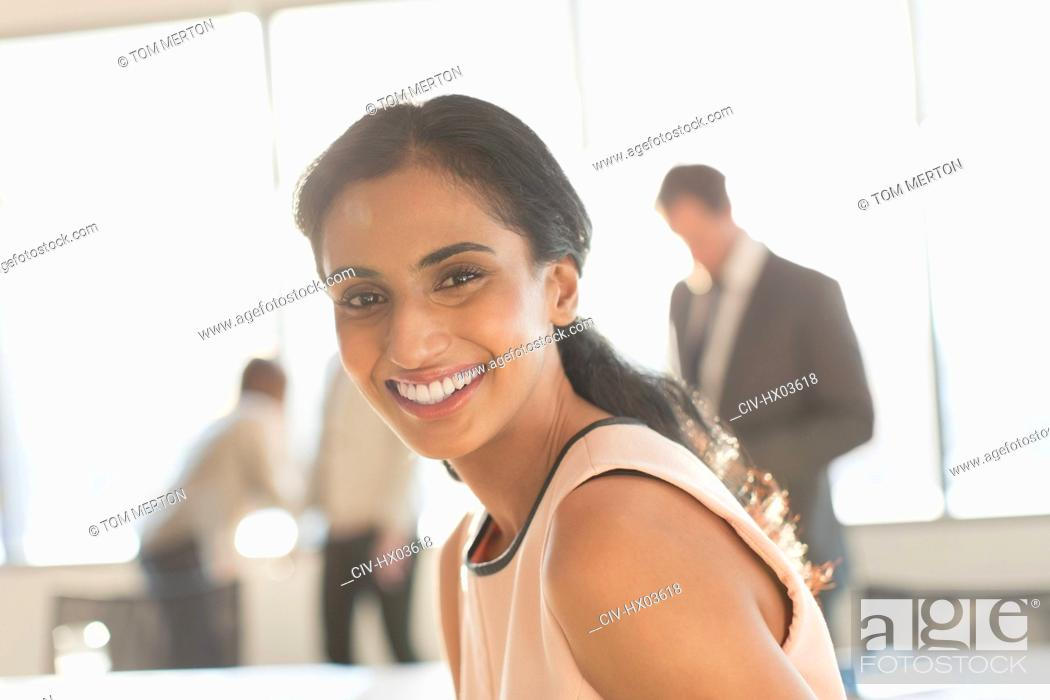 Stock Photo: Portrait smiling, confident businesswoman.