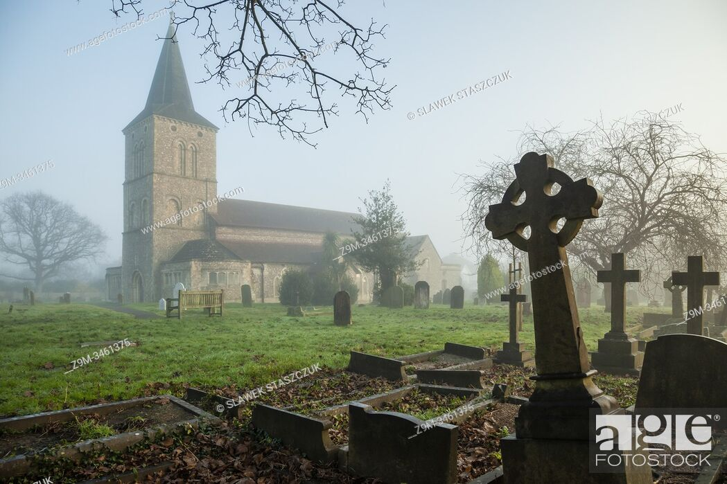 Stock Photo: Foggy winter morning at St Michael's church in Southwick, West Sussex, England.