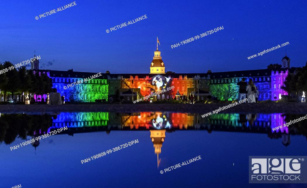 Stock Photo: 07 August 2019, Baden-Wuerttemberg, Karlsruhe: A rehearsal for the Schlosslichtspiele Karlsruhe 2019 will take place at Schloss Karlsruhe.