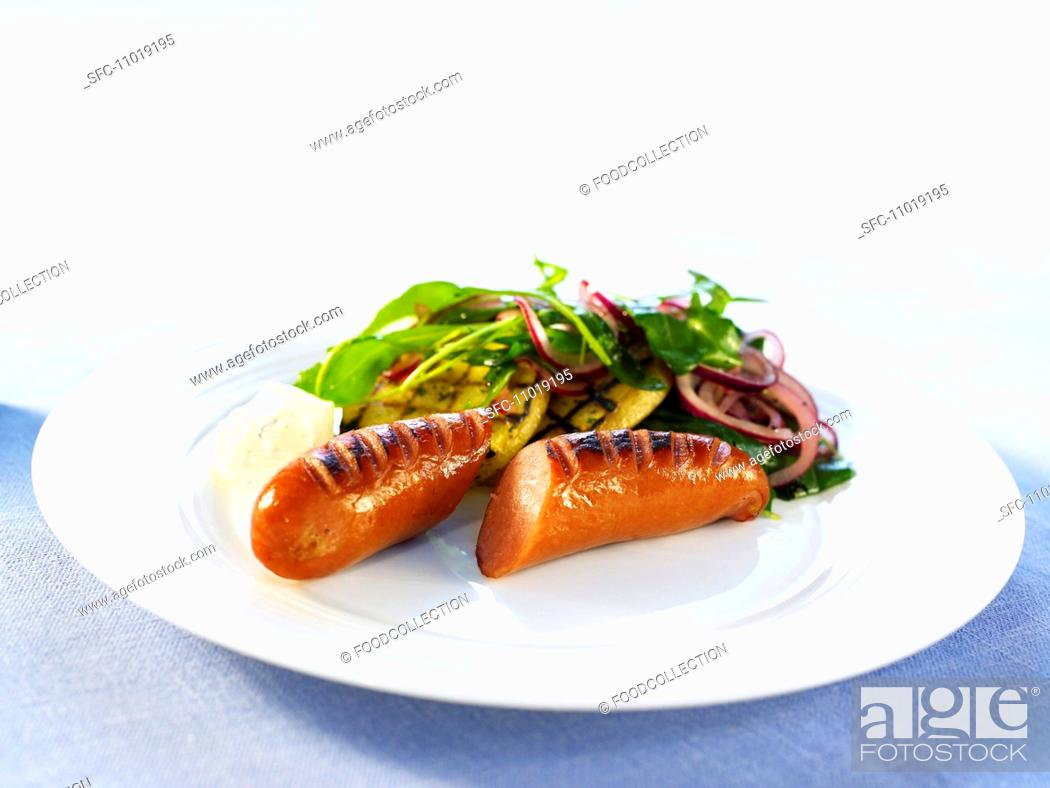 Stock Photo: Grilled sausage with a side salad.