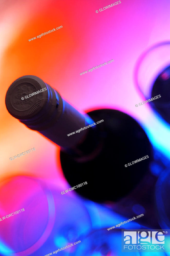 Stock Photo: High angle view of a wine bottle with three wineglasses.