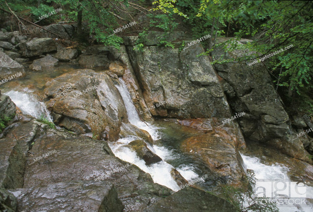 Stock Photo: Water flows over rain soaked rocks in a stream in New Hampshire, United States.