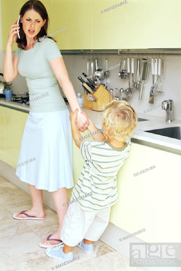 Stock Photo: Boy pulling on mother's arm.