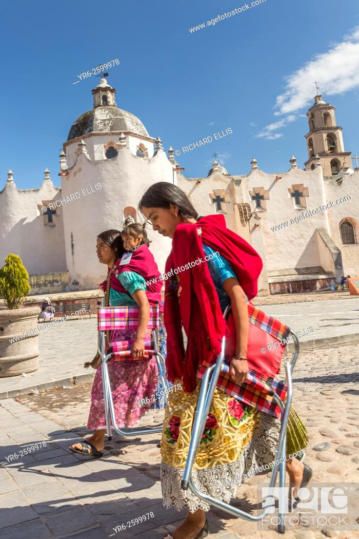 Stock Photo: Indigenous pilgrims holds a procession past the Sanctuary of Atotonilco an important Catholic shrine in Atotonilco, Mexico.