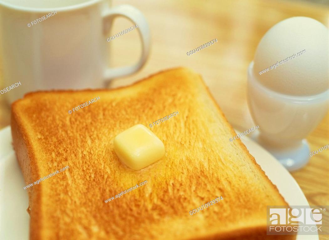 Stock Photo: Bread, An Egg, And A Coffee Cup.