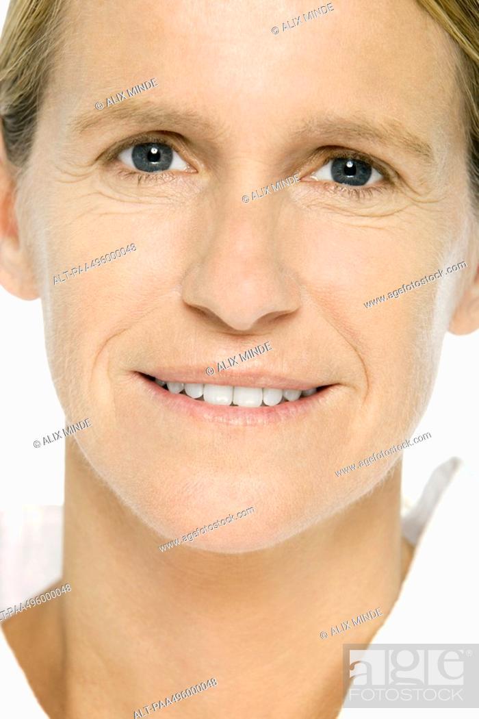 Stock Photo: Mature woman smiling at camera, portrait.
