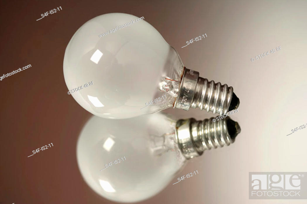Stock Photo: Electric bulb on an reflecting underlay, close-up.