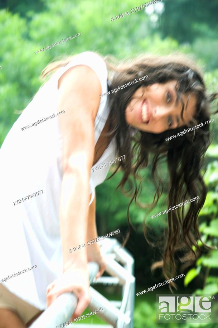 Stock Photo: Woman with wet hair in the garden.
